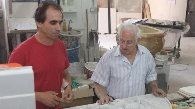 Alfred Camilleri Cauchi (right) and Raymond Bonello making the final plans for the erection of Bishop Emeritus Nikol Cauchi's tombstone at the cathedral in Victoria. Photo: Charles Spiteri