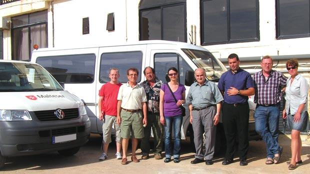 Arka director Mgr Emanuel Curmi (centre), with (from left) Matthias Schnell, Joe Cremona, John Attard, Snjezana Jancic, assistant Arka director Fr Michael Galea, Reiner Borschel and Claudia Schneider after the presentation of the new vans.