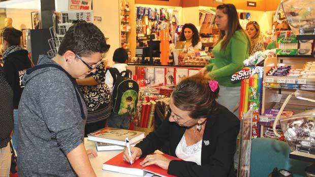Yana Mintoff Bland signing books at Arcadia in Victoria. Photo: Charles Spiteri