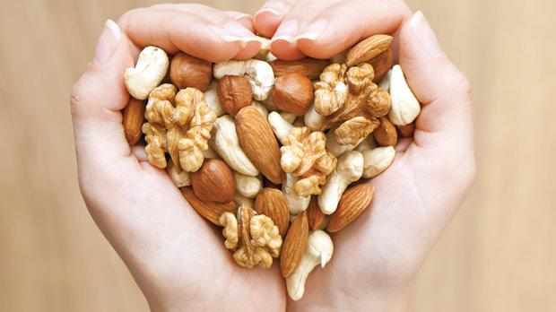 Researchers say nuts contain unsaturated fatty acids, vitamins, minerals and other nutrients which lower cholesterol and inflammation.