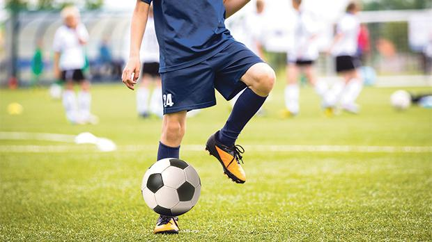 Playing football for as little as three hours a week may help bone development. Photo: Shutterstock.com