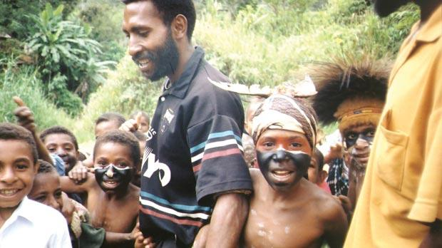 Children in Papua New Guinea. Right: Jared Diamond's book uses geography to show how Europeans and Asians developed some immunity to diseases which spread among them.