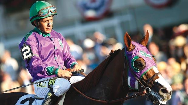 Jockey Victor Espinoza sits atop California Chrome after coming in fourth at the 146th running of the Belmont Stakes last weekend.