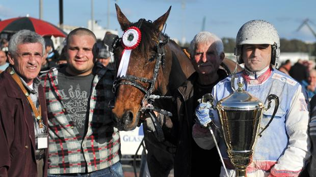 Noel Baldacchino (right) holds the trophy after the Gold Class final.