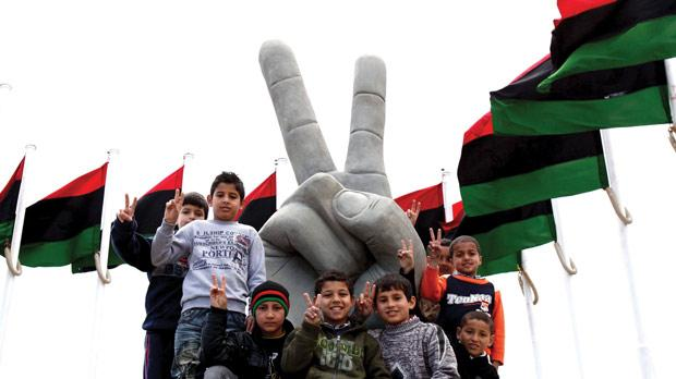 Children celebrating in Tripoli on Friday. Photo: AFP
