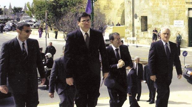 Richard Cachia Caruana (front), the former President of the European Commission Romano Prodi (centre) and then-Prime Minister Eddie Fenech Adami walking up the steps of Castille.