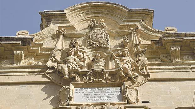 Britain's royal insignia on top of Grandmaster Marcantonio Zondadari's baroque ensemble in Merchants Street, Valletta.