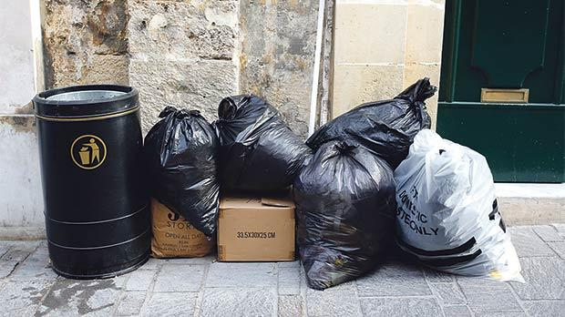Garbage bags are left on pavements or streets and are only collected a few hours later, plenty of time for alley cats to rip and make a mess of the bags. Photo: Darrin Zammit Lupi.