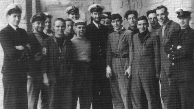 The Royal Navy's most successful submarine commander, M. D. Wanklyn, VC, DSO (centre), with some of the crew of HMS Upholder.