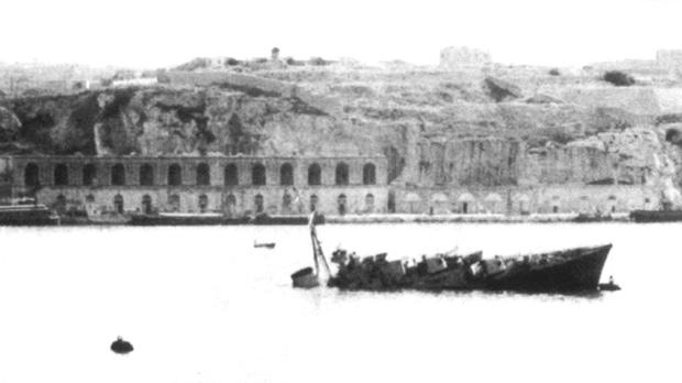 HMS Maori sunk at her moorings, with her bows still tied to the buoy in Grand Harbour.
