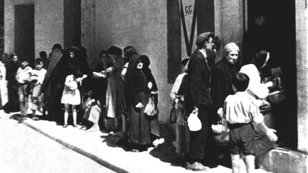 People queueing for their hot meal. The first Victory Kitchen was opened on January 3, 1942.