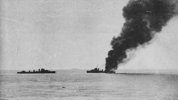 The destroyer HMS Fearless on fire and disbaled on the morning of July 23, 1941.