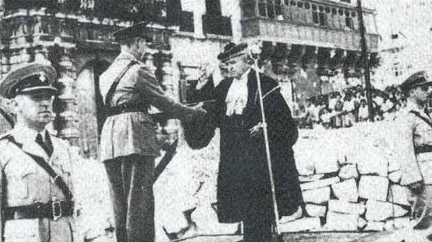 The Chief Justice, Sir George Borg, receiving the George Cross on behalf of the people of Malta from the Governor, Lord Gort, at Palace Square on September 13, 1942.