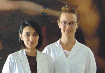 Conservators Amy Sciberras and Paola Belletti, who were involved in the paintings' restoration.