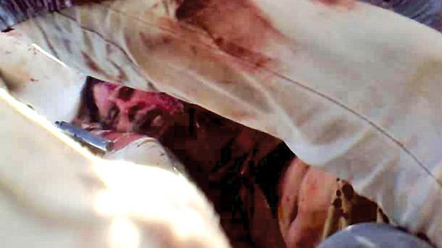 Video grab of Muammar Gaddafi soon after he was shot dead, yesterday, in Sirte. Photo: AFP