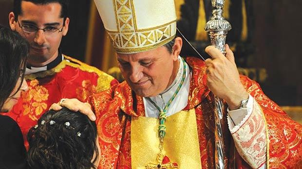 Gozo Bishop Mario Grech administering the sacrament of confirmation to a young girl on Sunday.