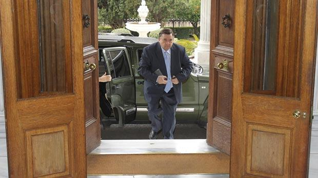 George Karatzaferis, leader of the rightist Laos party, arriving at the Presidential palace in Athens, yesterday. The leader of a junior partner in Greece's coalition government, he says he will not vote for new austerity measures, required for a massive new bailout deal to avoid bankruptcy.