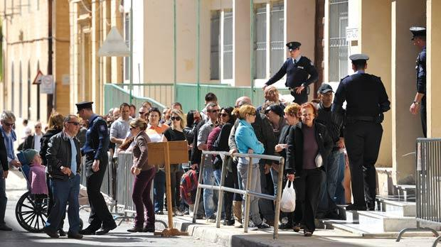 Voters queue outside the polling station in Valletta yesterday. Photo: Matthew Mirabelli