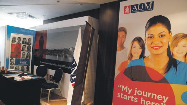 A poster at CHOGM advertising the American University of Malta. Photo: Darrin Zammit Lupi