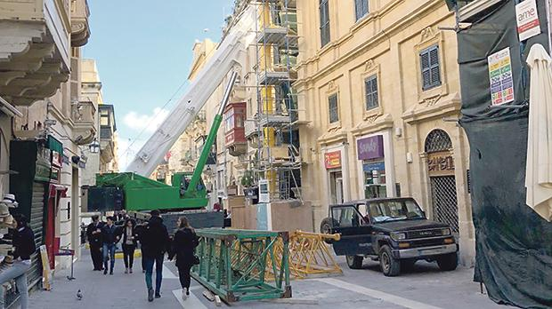 The crane blocking Merchants Street, Valletta yesterday.