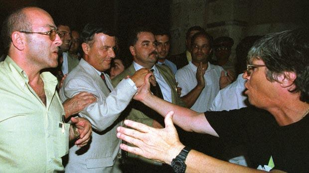 Prime Minister Alfred Sant (second from left) greeted by supporters outside Parliament in July 1998 after losing the vote of confidence. Photo: Darrin Zammit Lupi