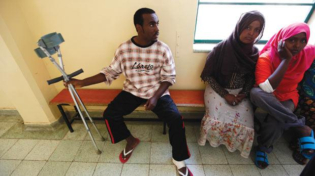 Eritrean Michael Tekeste, who was shot in the foot while escaping a Libyan detention centre, which had little food or water and no medical supplies. Photos: Darrin Zammit Lupi