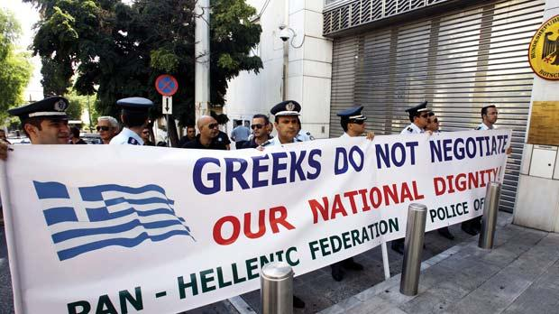 Greek policemen and firemen staged a protest outside the German embassy in central Athens, yesterday. Greece is swept by strikes and demonstrations amid new budget cuts as European stocks plunged, with doubts growing that the government can force through the latest EU-IMF conditions for funds to avert default and resulting chaos in the eurozone. Photo: AFP