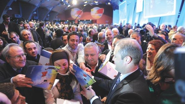 Labour leader Joseph Muscat signing copies of the party's manifesto at its conference last night. Photo: Jason Borg