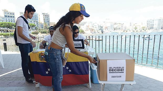 Venezuelan opposition holds poll to determine Maduro's support