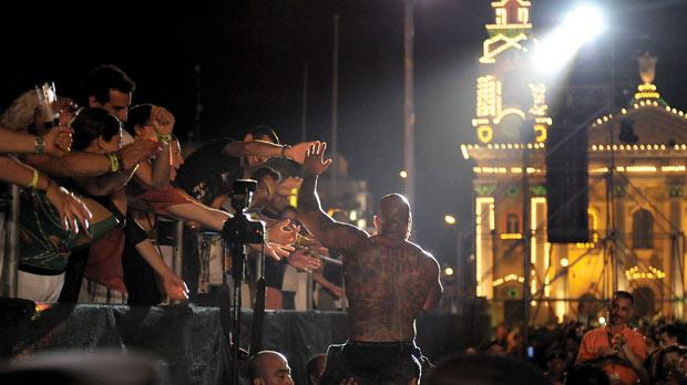 Top USrapper Flo Rida gives high-fives to fans in the crowd during yesterday's concert.