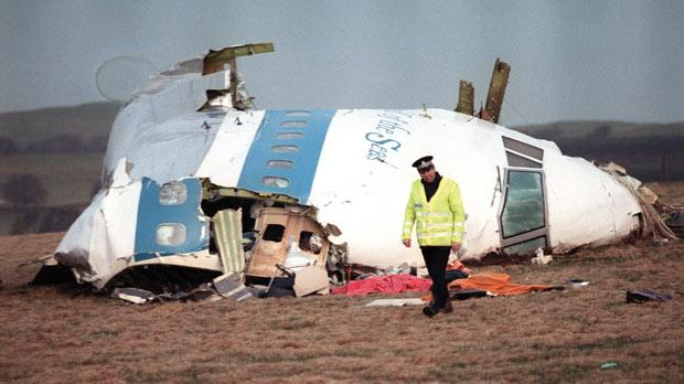 A policeman patroling the area covered with debris of Pan-Am flight 103 in Lockerbie, Scotland, in 1988.
