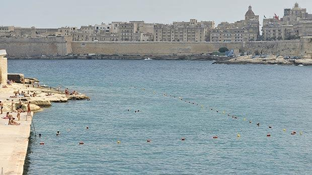 Sliema residents swimming at Tigné have complained to the local council that the swimming zone there is smaller, despite the transport authority saying this is not the case. Photo: Chris Sant Fournier