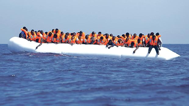 A group of migrants making the dangerous Mediterranean crossing on a rubber dinghy. Photo: Darrin Zammit Lupi