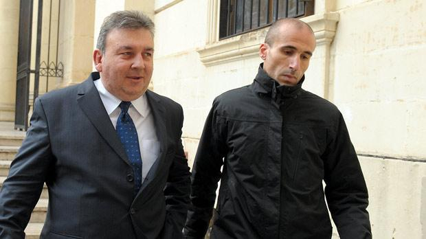 Silvio Zammit, left, leaves court accompanied by Inspector Angelo Gafà on Tuesday. Photo: Matthew Mirabelli
