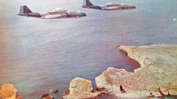 Canberra PR Mk 7 aircraft of No. 13 (PR) Squadron flying over Comino.