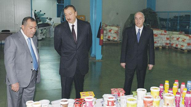 President Aliyev (centre) tours one of Mr Khangah's Baku factories.