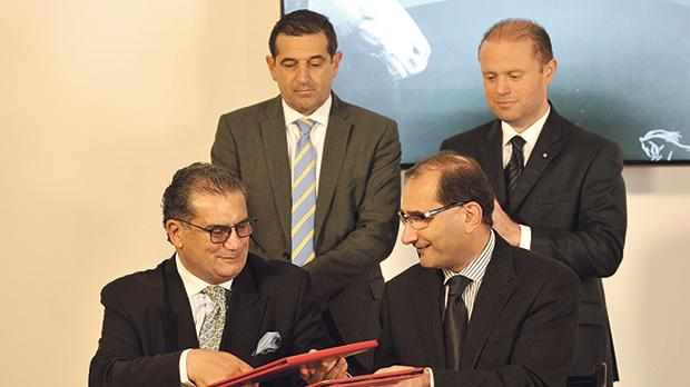 Pio Valletta (left) and the former Education Ministry permanent secretary, Joseph Caruana, signing the deal as Prime Minister Joseph Muscat and Parliamentary Secretary Chris Agius look on.
