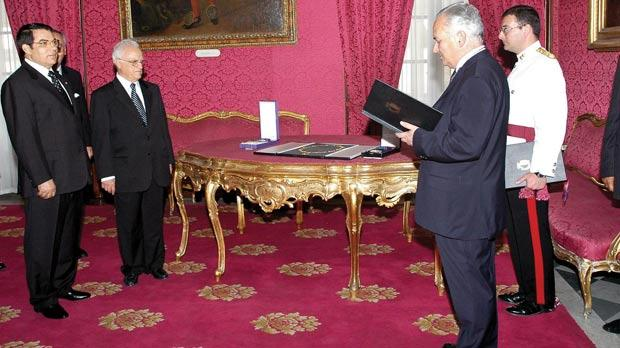 Former Tunisian President Zine El Abidine Ben Ali (left) receiving the National Order of Merit in 2005.
