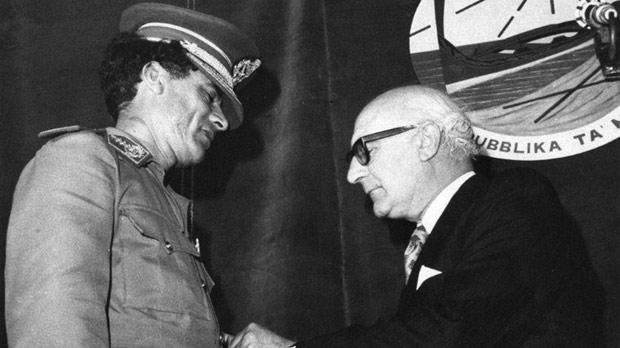 Colonel Muammar Gaddafi being awarded the Xirka Ġieħ ir-Repubblika in 1975.