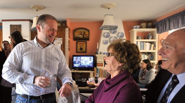 Joseph Muscat at home with his parents yesterday. Photo: Jason Borg