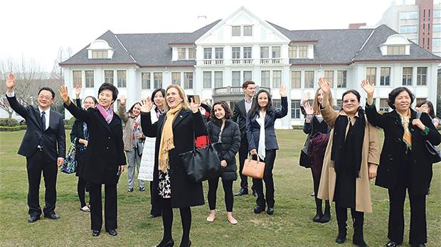 Last month, a picture in The Shanghai Daily showed Ms Mizzi Liang waving to reporters alongside her colleagues. She is fourth from right.