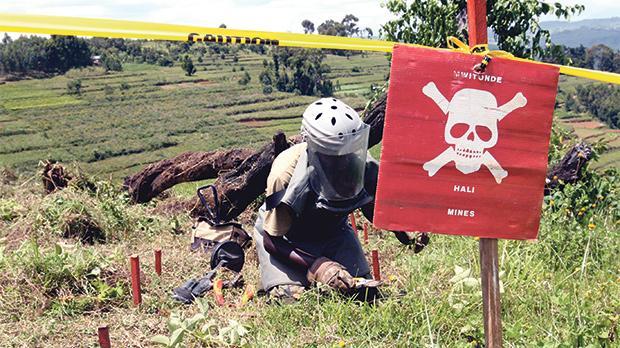 Checking for landmines on a Rwanda hill.