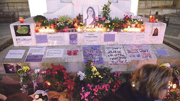 Flowers, wreaths and messages paying tribute to journalist Daphne Caruana Galizia at the foot of the Great Siege Monument. Photo: Mark Zammit Cordina