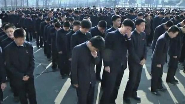 Young men shed tears as they mourn the passing of their revered North Korean Leader Kim Jong-il.