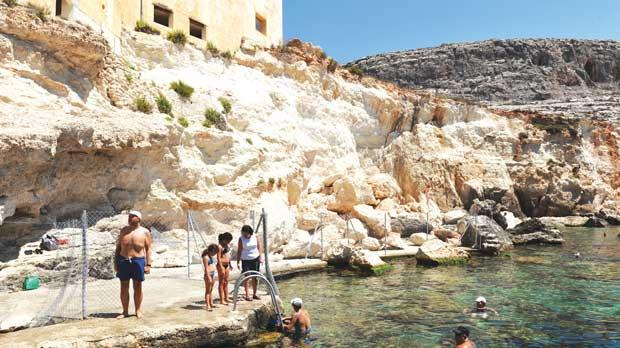 Swimmers enjoy a dip in the scenic area despite the crumbling rocks. Photos: Chris Sant Fournier