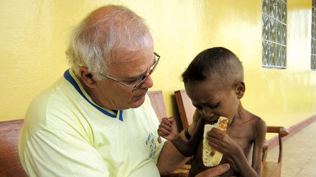 Fr Dun George Grima of Maltese charity Jesus in Thy Neighbour shares food with Mebratu, a five-year-old Ethiopian boy who had never eaten bread before Fr Grima helped him.