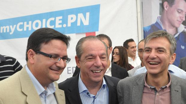 Prime Minister Lawrence Gonzi in Qrendi yesterday, flanked by PN deputy leadership contenders Tonio Fenech (left) and Simon Busuttil. Photo: Jason Borg