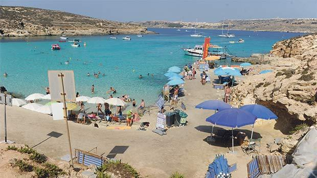 As many as 5,000 visitors land on Comino daily at the peak of the summer season, many of them spending their whole time at the Blue Lagoon. Photo: Steve Zammit Lupi