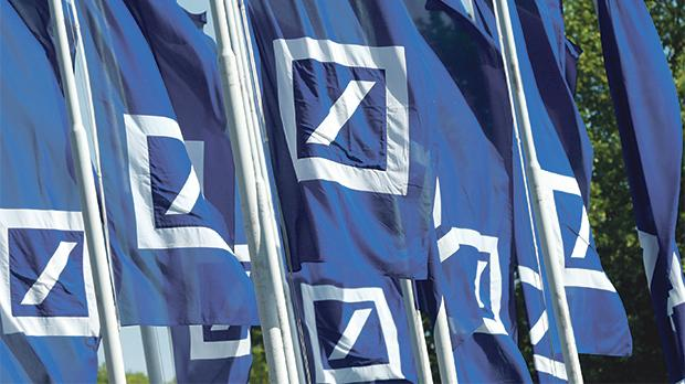 Flags with the logo of Deutsche Bank are seen at the headquarters in Frankfurt, Germany. Photo: Reuters