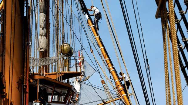 Two crew members working high up among a web of hemp ropes, true to the ship's 1930s ethos. There are a couple of Fiat engines hidden down below however, just in case there is no wind. Photos: Darrin Zammit Lupi